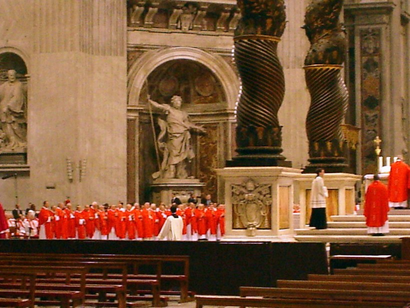 The size of these idols describes the men in red as The Cardinals worthy to stand in this great body of Christ.